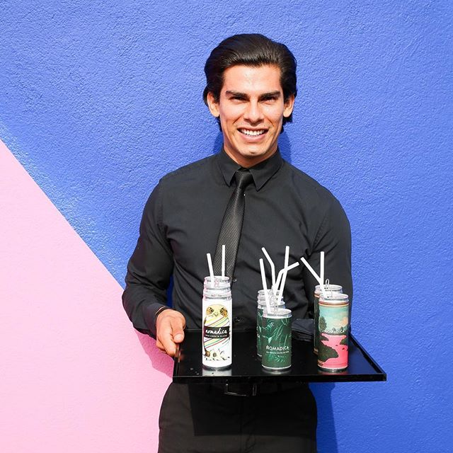 A beautiful man, serving ice cold cans of wine, in front of a gorgeous rainbow wall, on a warm night in LA ⚡️ #lifegoals