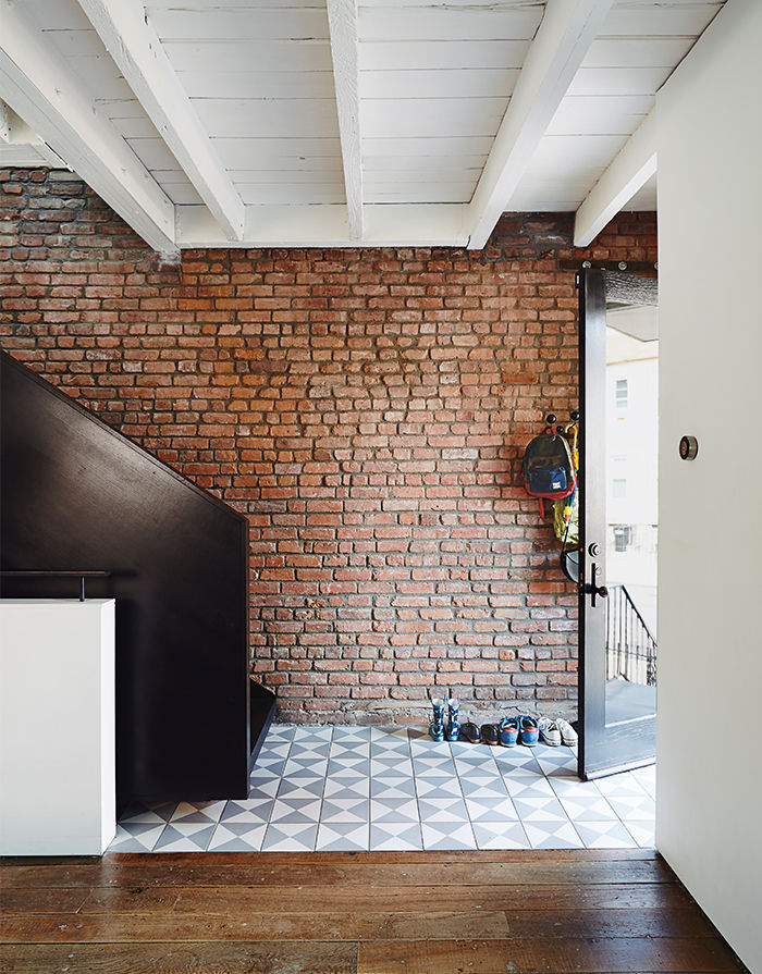 practical_magic-brooklyn-renocation-blackened-steel-staircase-reclaimed-ash-flooring.jpg