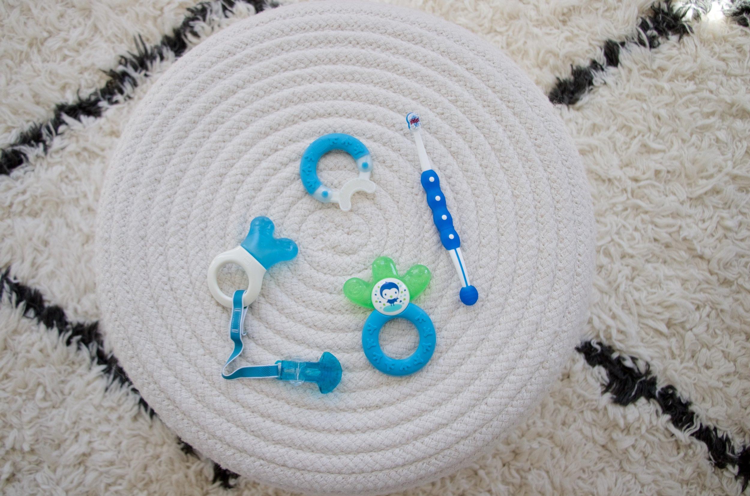 From Left clockwise: Mini Cooler, Bite & Brush, Training Brush, Cooler