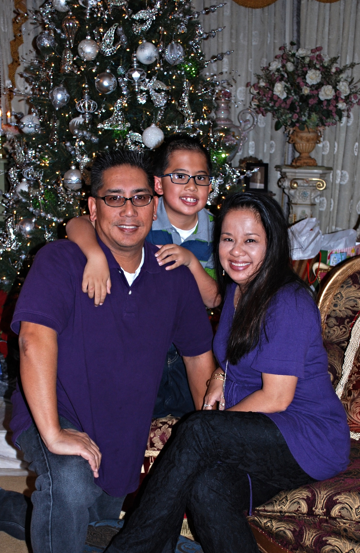 Left to Right: Bro. Robert, his son Evory, and wife Ana