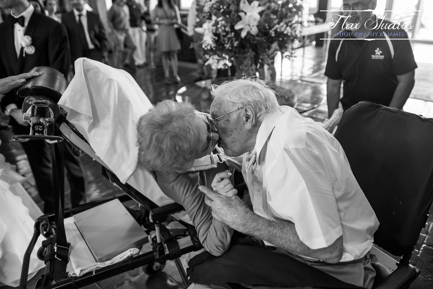 """It's hard to pick a favorite moment from the day, but this was such an emotionally beautiful moment, and probably my favorite! The morning of the wedding, the Grandmother took a terrible fall which resulted in a trip to the hospital. She was, very sadly, not expected to join in on the day's festivities. After the the ceremony though, we arrived back at the samoset where an an ambulance was waiting with grandmother to greet them! This moment brought me to tears as her husband in a wheelchair came to greet his bride on a gurney. It was such a happy moment for her to have made an appearance or as she put it, """"I'm known for making grand entrances, you shouldn't expect anything less"""". That may be a slight paraphrase, but that was the gist of it!"""