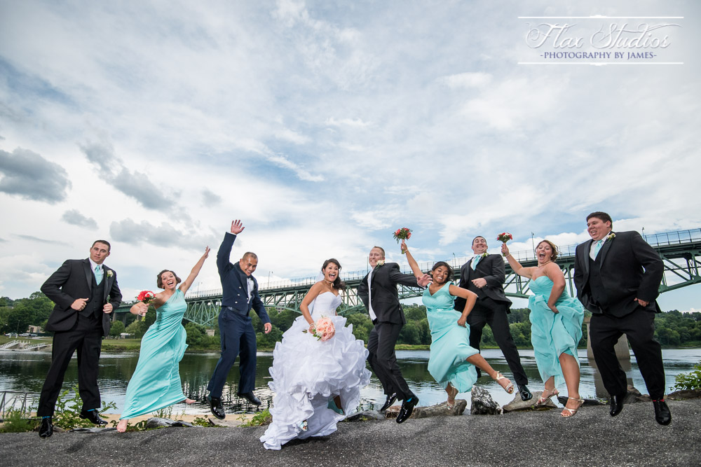 Fun Jumping Photo With Bridal Party