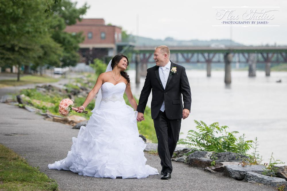 Bride and Groom Walking In The Rain Flax Studios