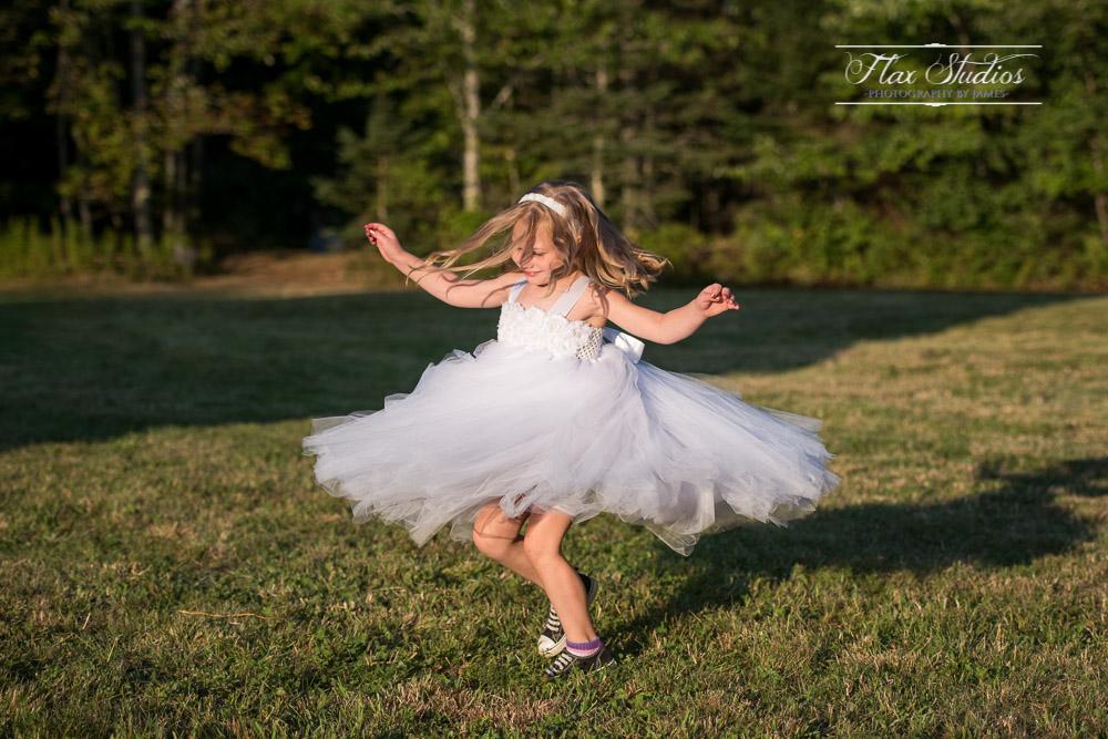 Flower Girl Spinning In Her Dress