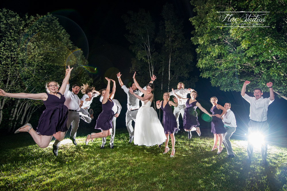 jumping Bridal party shot in the dark