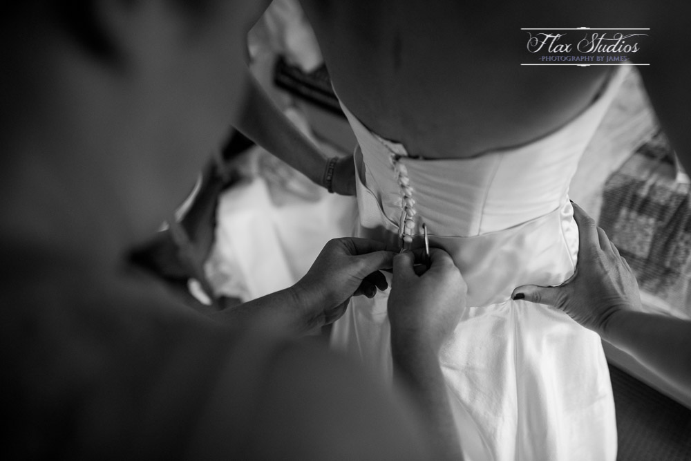 Buttoning up the dress