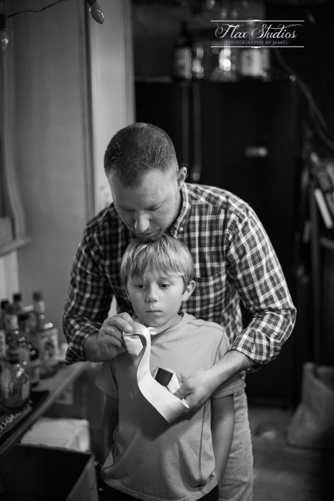 Father helping his son tie a tie
