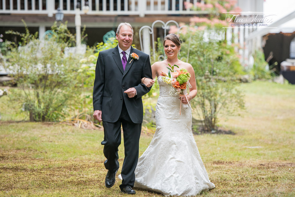 Father and Daughter going down the aisle