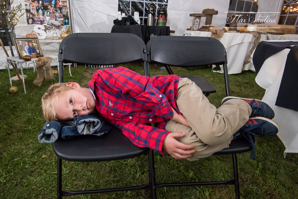 funny tired kid during reception