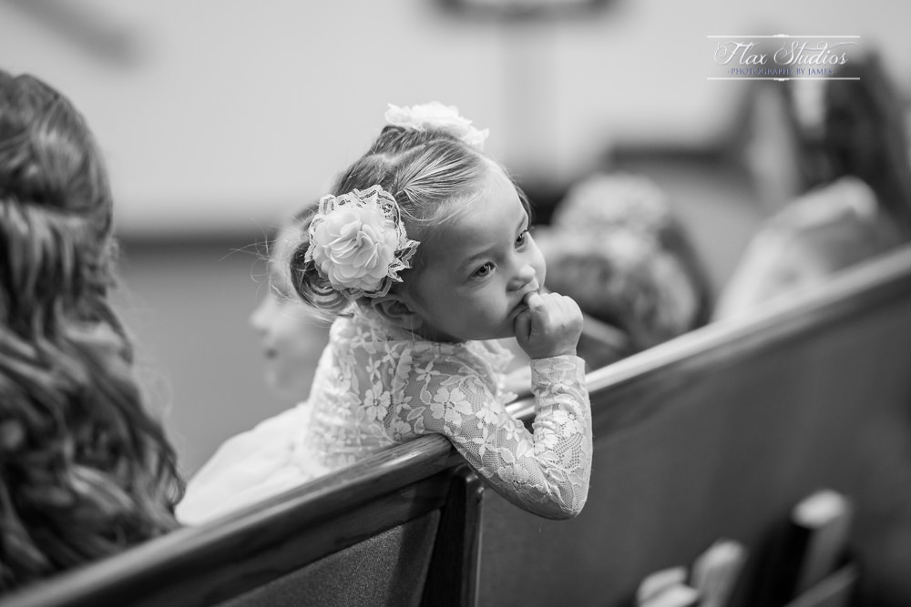 little girl looking around during the ceremony