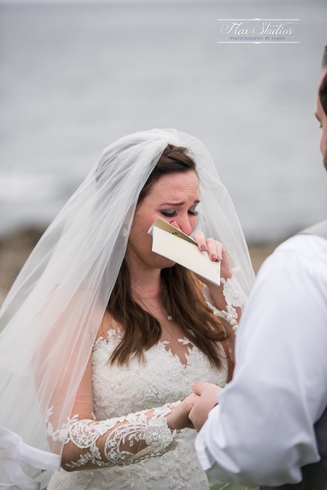 bride tearing up during her vows