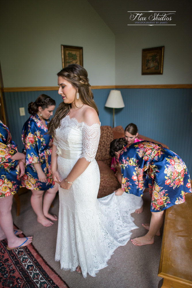 Bridesmaids help with the wedding dress