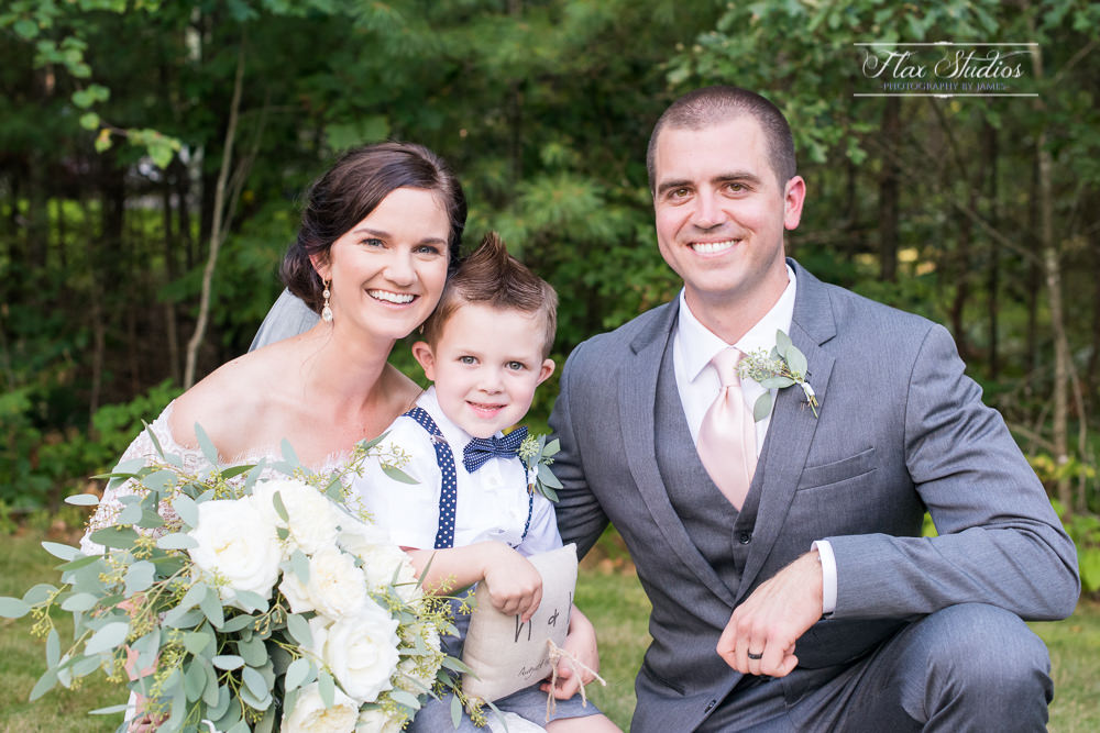bride and groom with the ringbearer