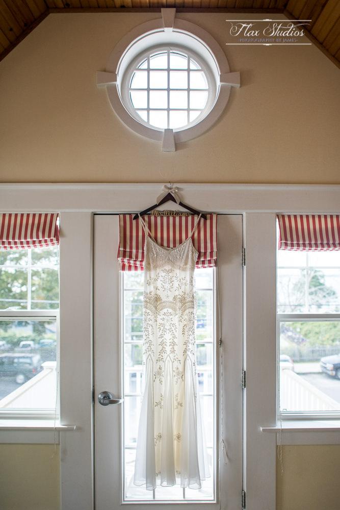 Peaking Island Wedding Dress Hanging in the window