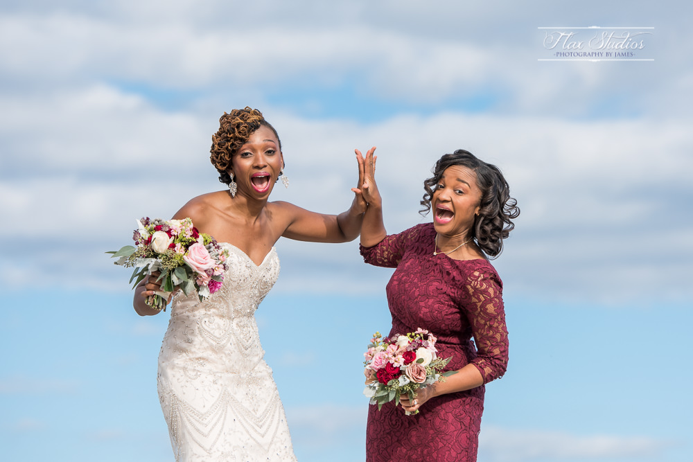 sisters having fun during the wedding photos