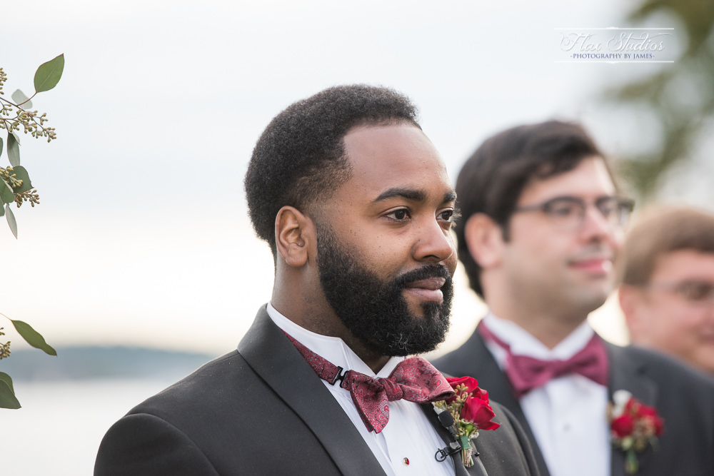 groom waiting for his bride to come down the aisle