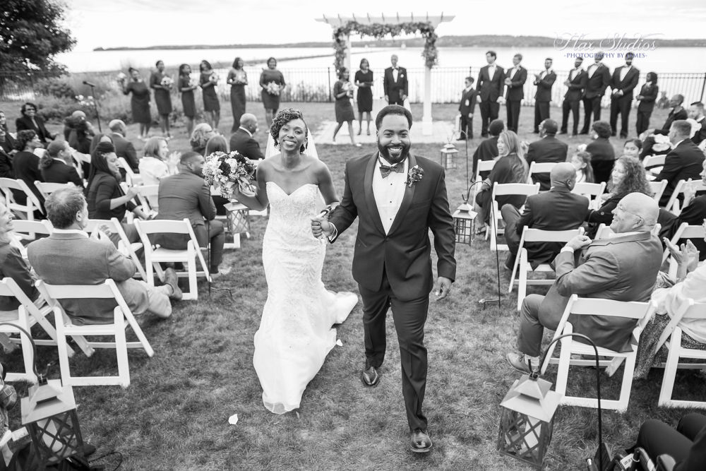 bride and groom walking back down the aisle together