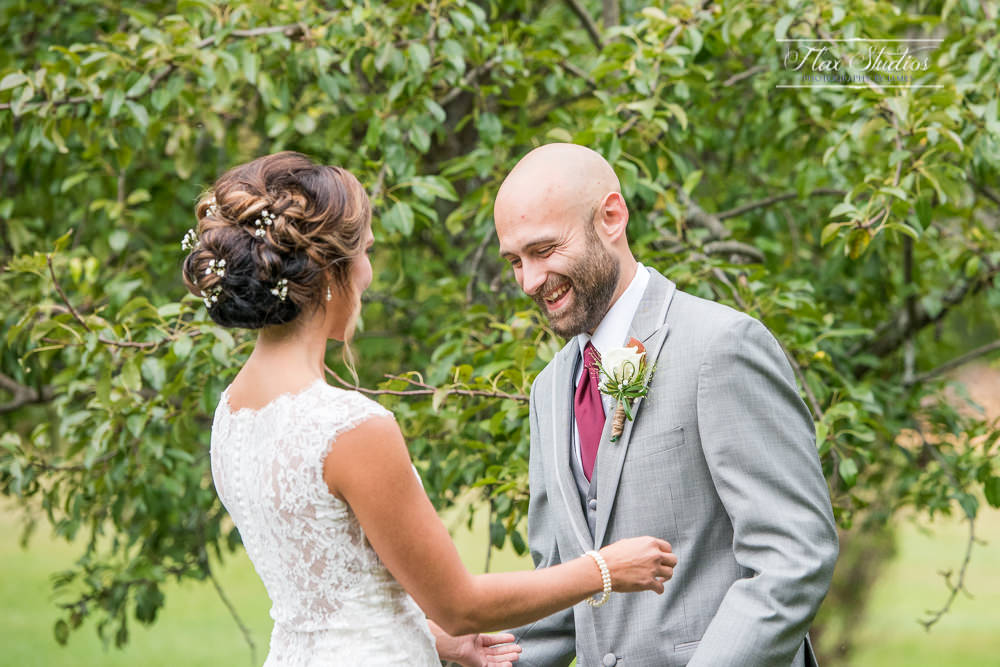 bride and grooms first look at worthley pond