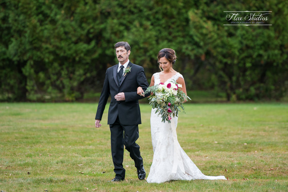 a father walking his daughter down the aisle