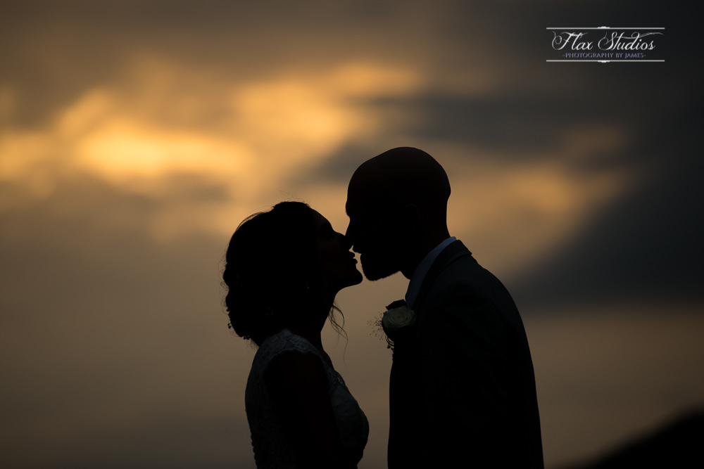 sunset silhouette photo with the bride and groom
