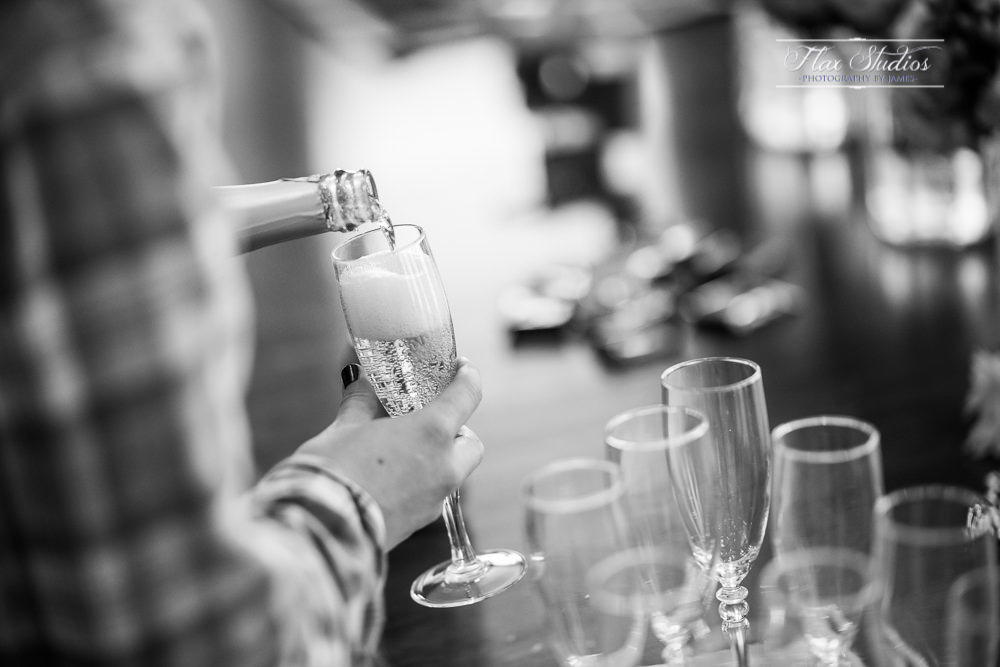 pouring champagne during the getting ready photos