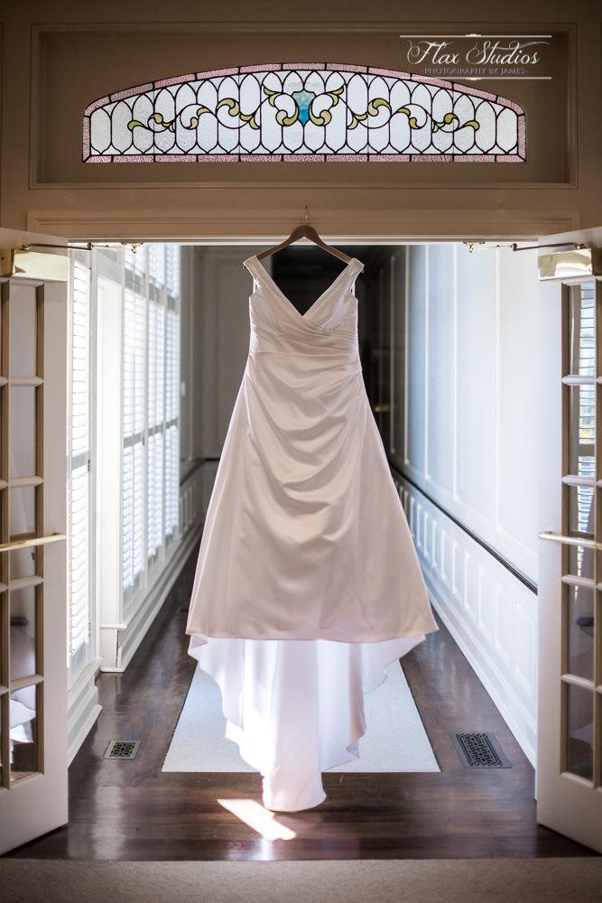 wedding dress photo ideas hanging in door openings