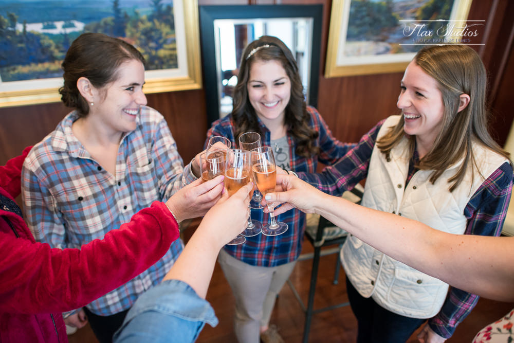 bridesmaids toasts with champagne