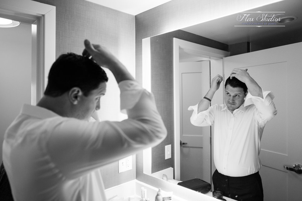 groom getting ready in the bathroom