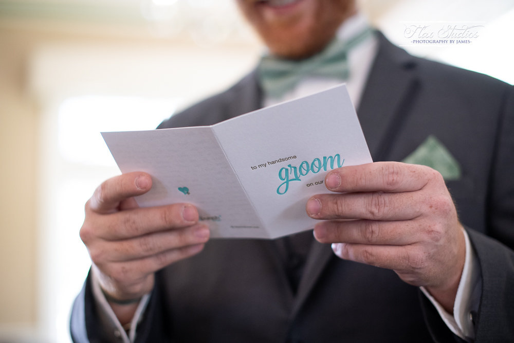 reading a letter from his bride before the first look