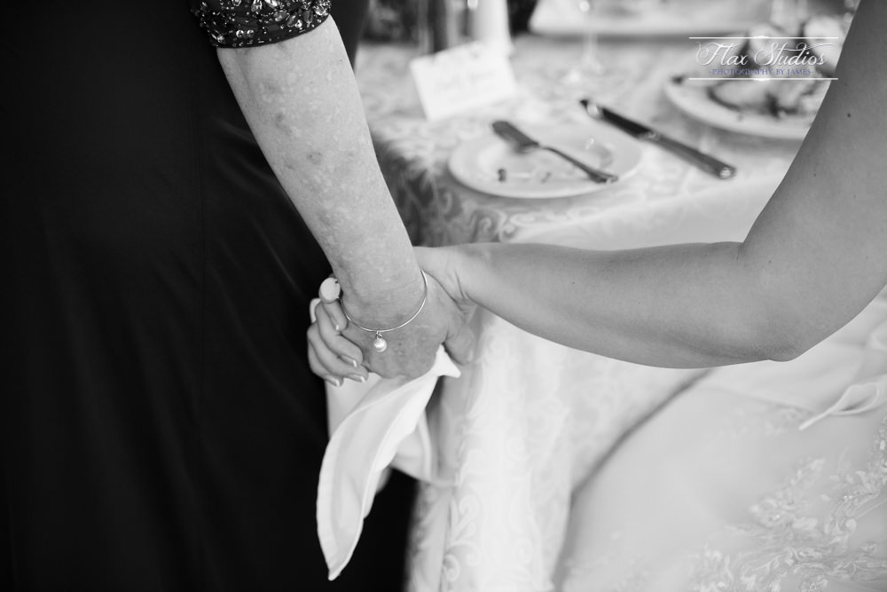 intimate moment between mother and the bride
