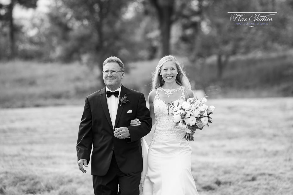 dad escorting his daughter on her wedding day