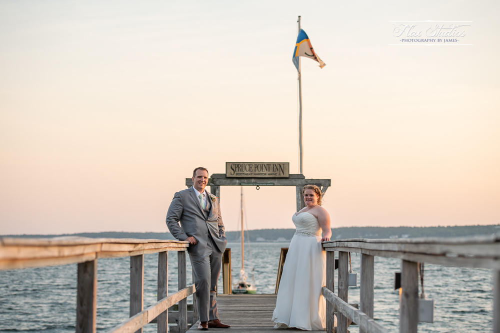 bride and groom portraits on the dock at spruce point inn