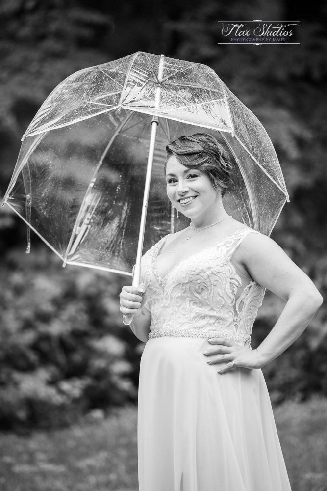 black and white bridal portraits in the rain