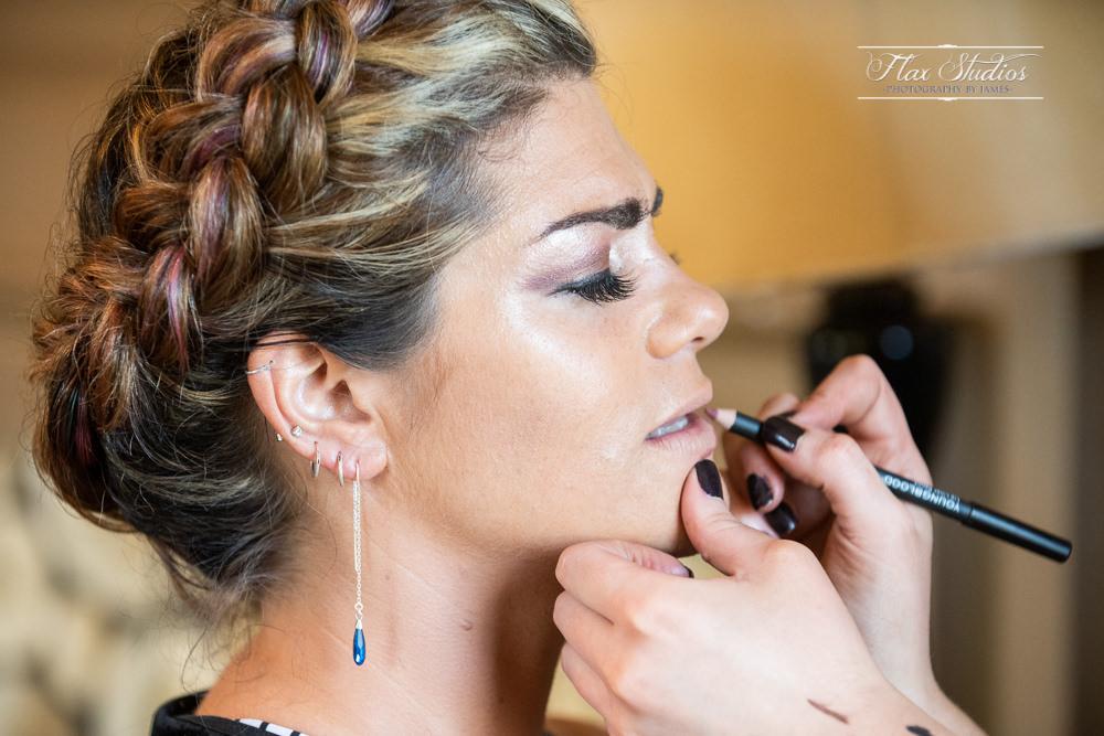 bride having her makeup done