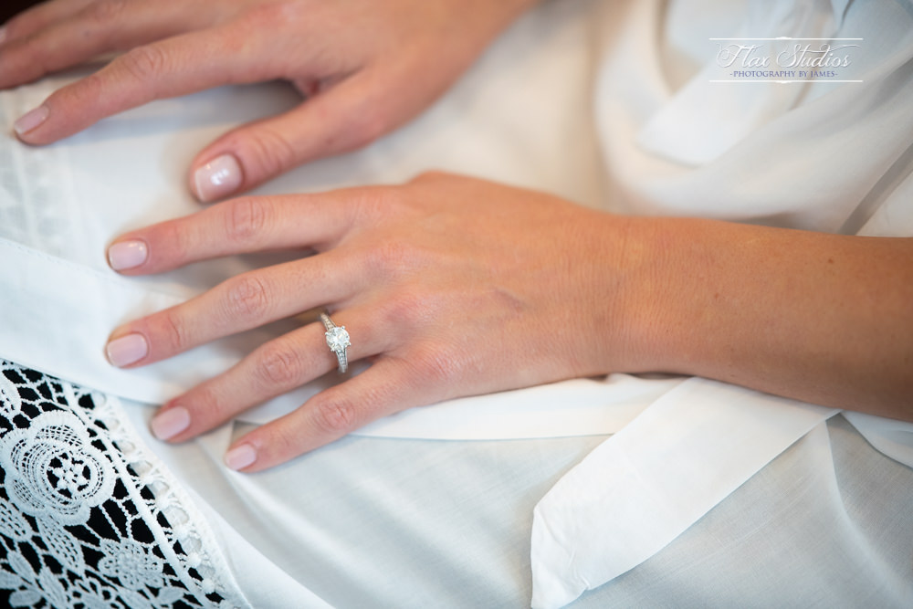 close up of the brides engagement ring