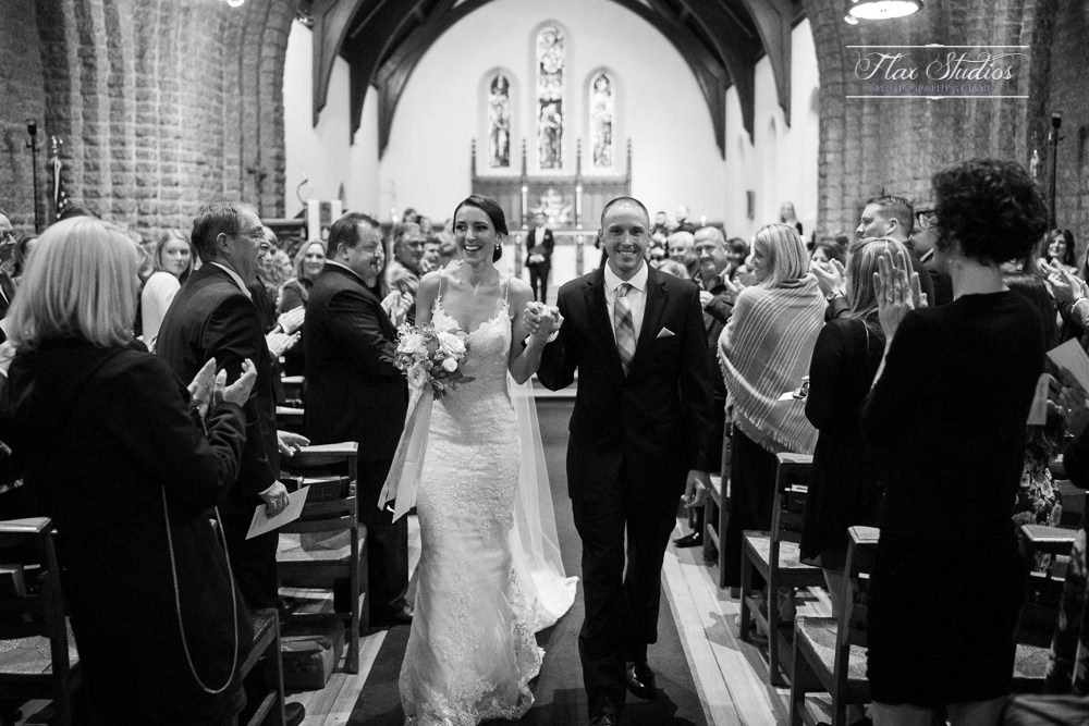 bride and groom exiting the church together
