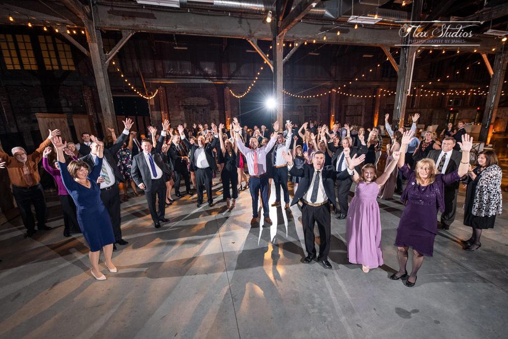 large group wedding photo on the dance floor