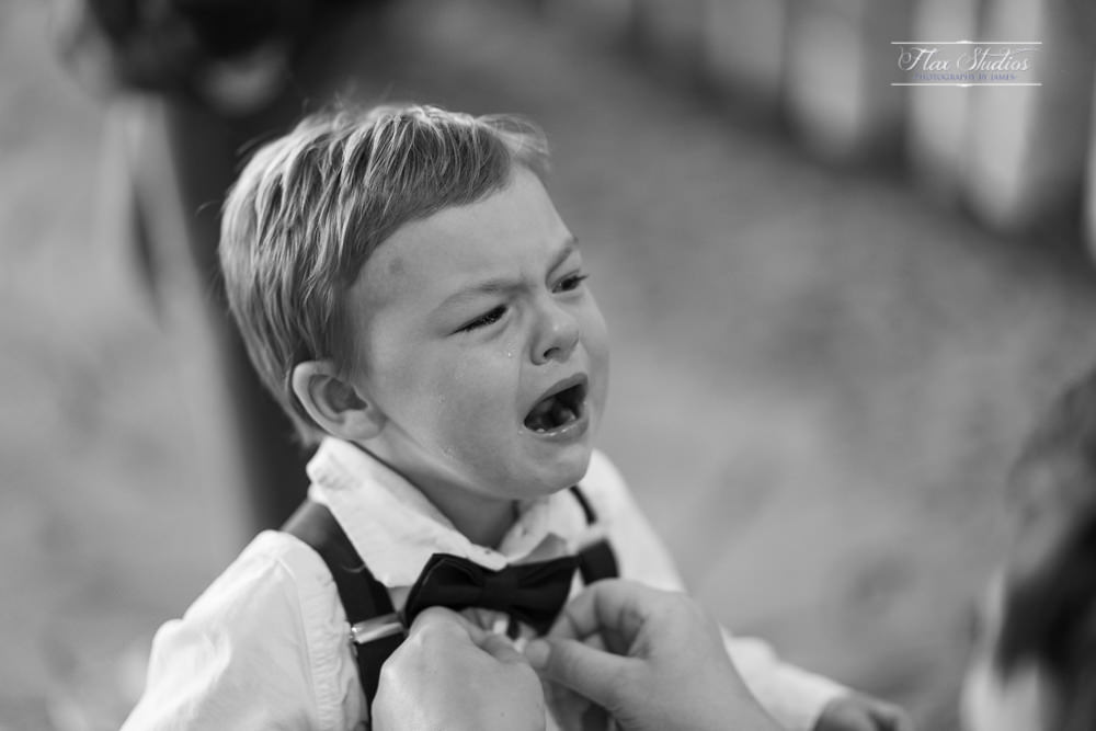 little boy crying while getting ready for the wedding