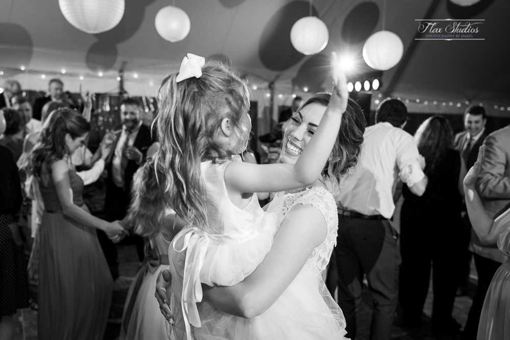 fun dancing photos with the flower girl and the bride