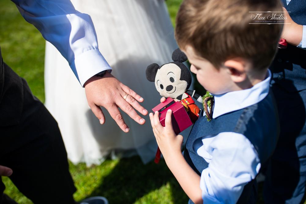 ring bearer inspecting the wedding ring