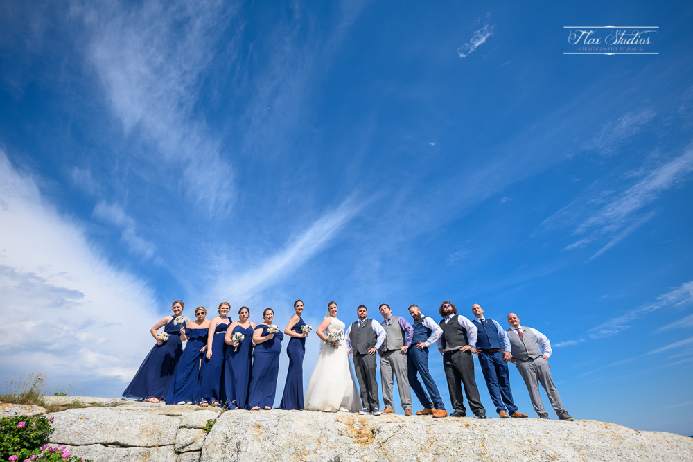 ultrawide wedding party photo on the rock at Pemaquid