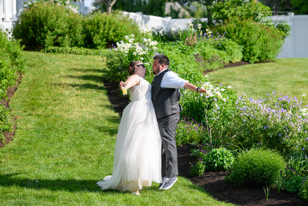 The bride and groom have a fun time entering the reception