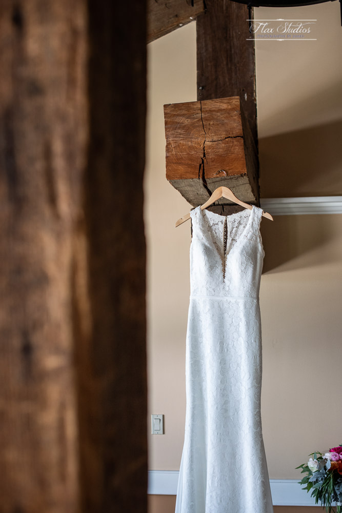 Wedding dress hanging on the timber beams