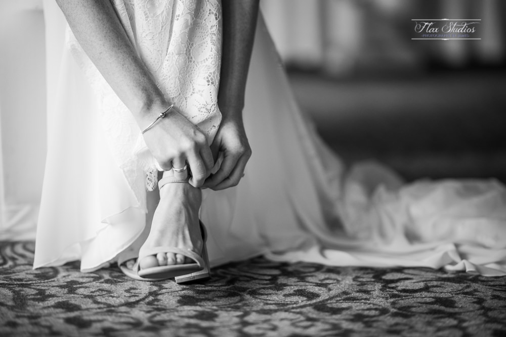 The bride putting on her wedding shoes