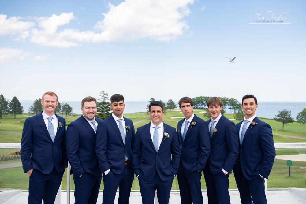 groom and groomsmen photos on the Oceanside deck of the samoset