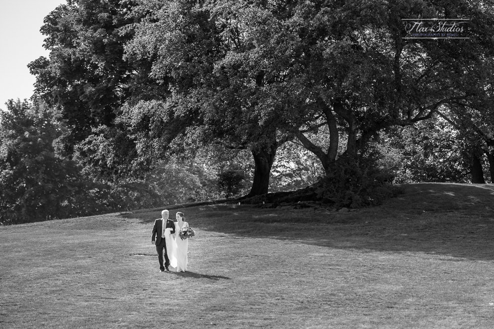 father walking with his daughter to the wedding ceremony
