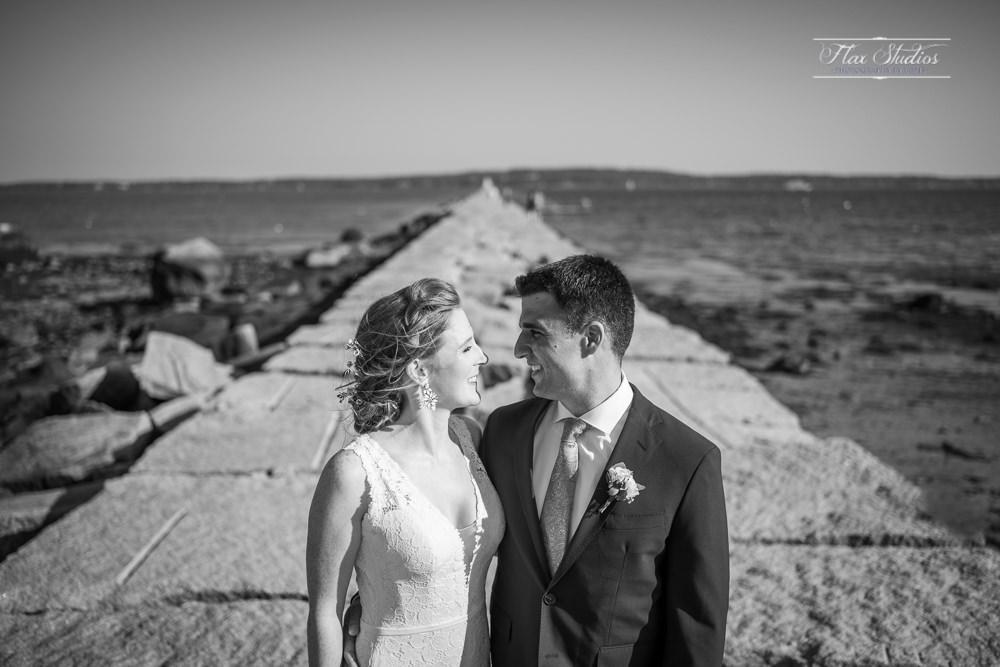 Black and white wedding photos on the breakwater
