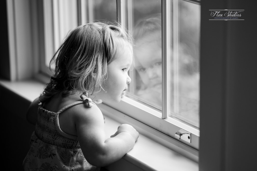 little girl looking out the winder