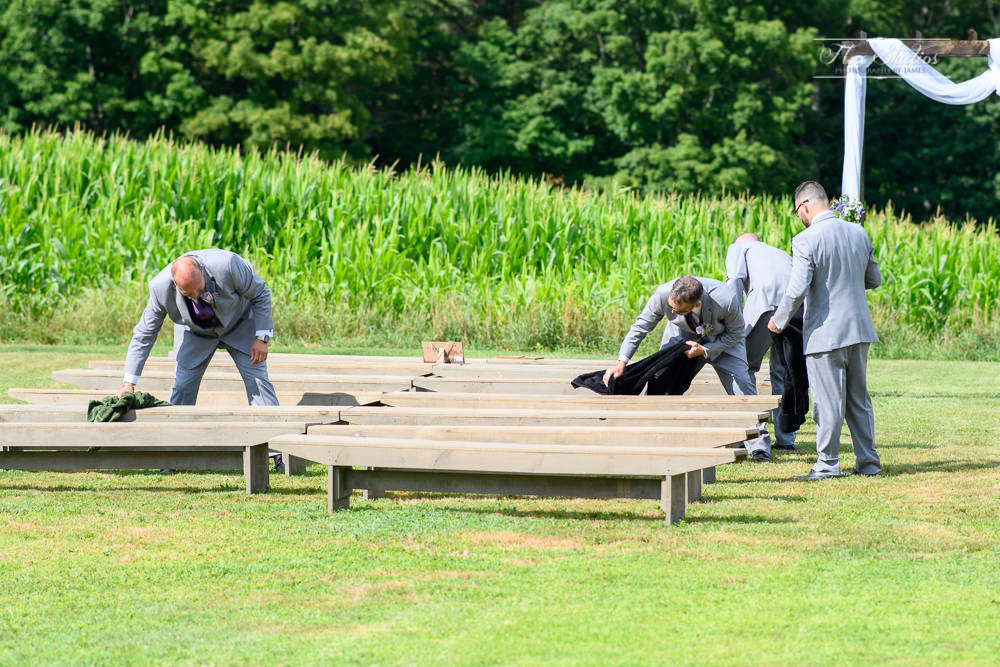 cleaning the benches to prepare for the ceremony