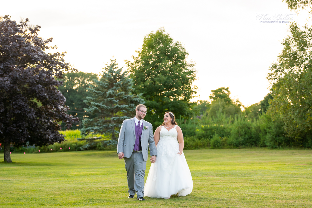 a walk at sunset with the bride and groom